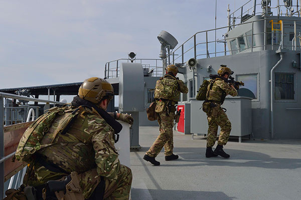 Royal Marines with 42 Commando secure a ship