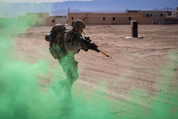 Royal Marine moving through smoke.