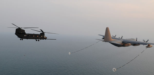 Chinook refueling in flight from Hercules